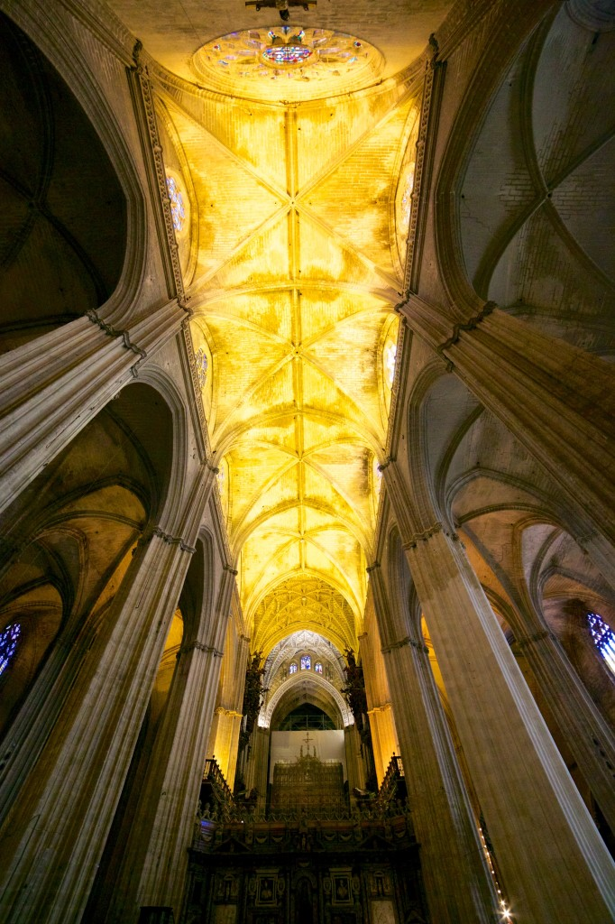The massive vaulted ceiling of the Seville Cathedral