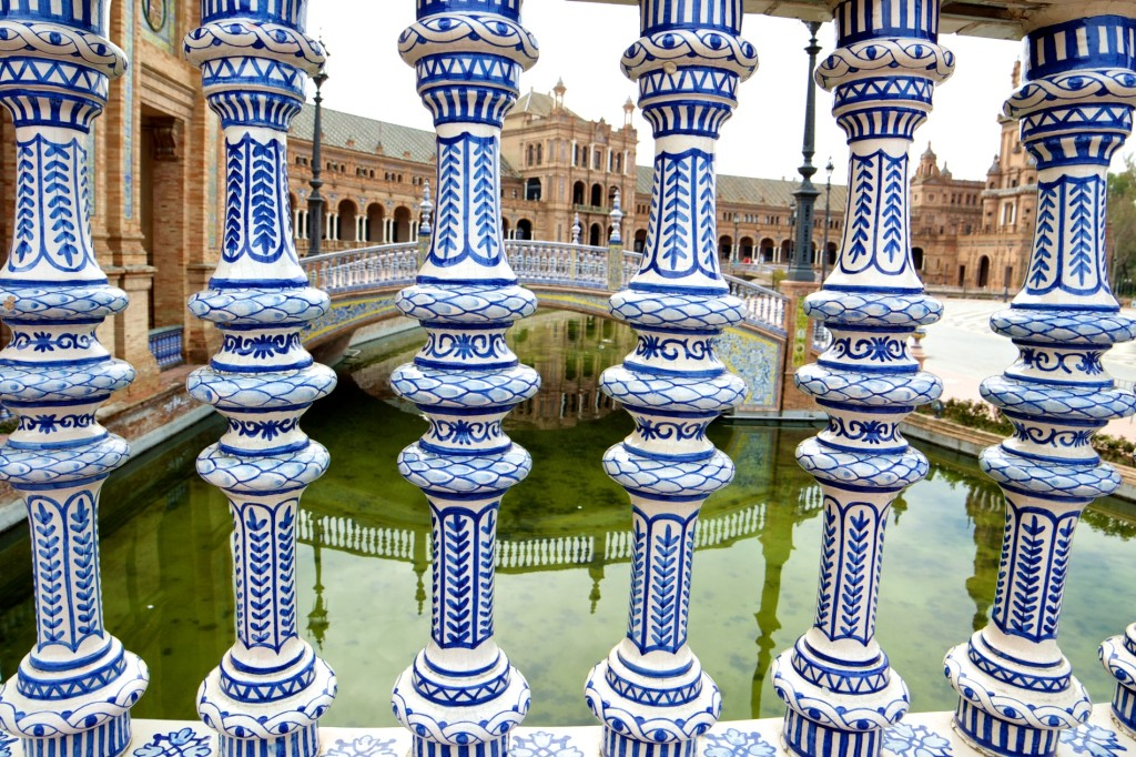 A view through a porcelain balustrade at the impressive Plaza de Espana.