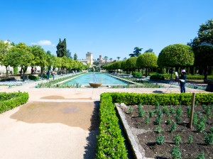 An artist attempts to reproduce the view down the length of the Alcazar gardens.