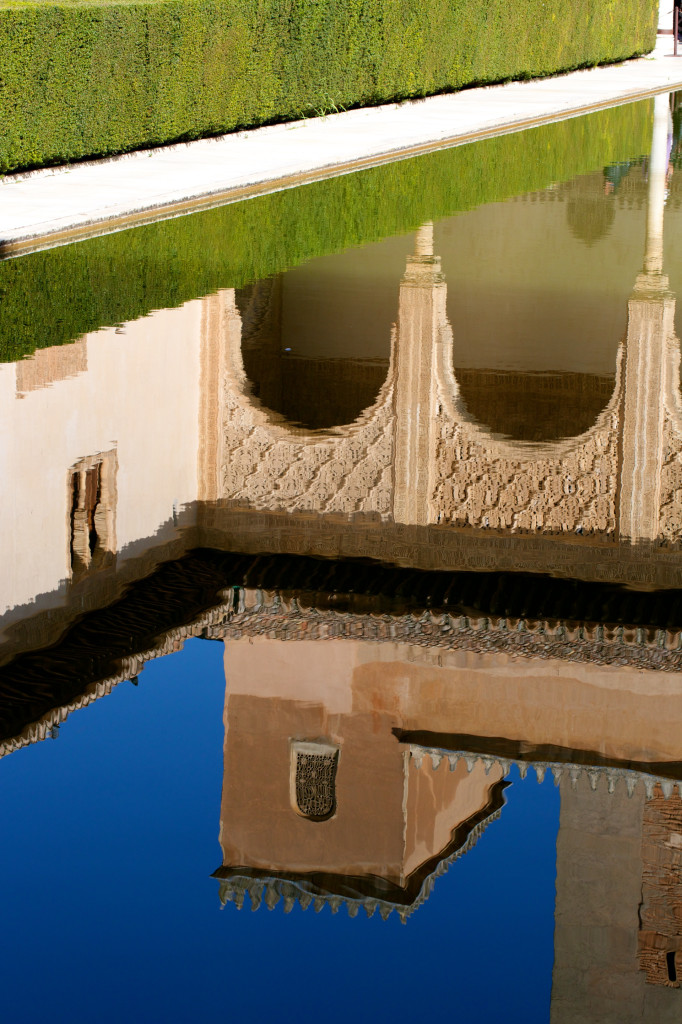 Reflection of bright greens and blues amid the Alhambra.